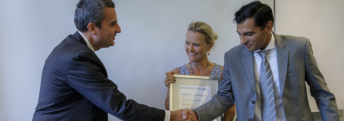 Orkla Health exectuives receive certificate from DNV GL - Business Assurance CEO Luca Crisciotti